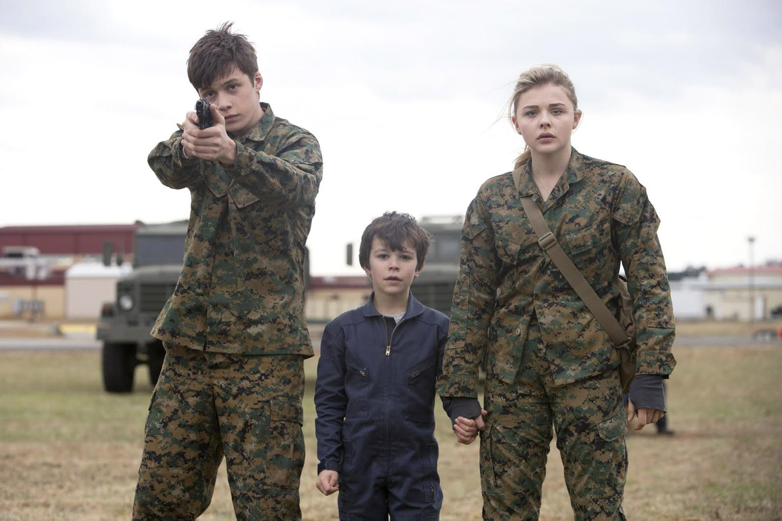 """L-r, Nick Robinson, Zackary Arthur and Chloë Grace Moretz star in Columbia Pictures' """"The 5th Wave."""""""