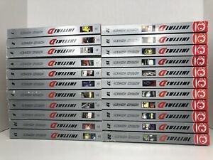 Two stacks of Initial D manga volumes side by side