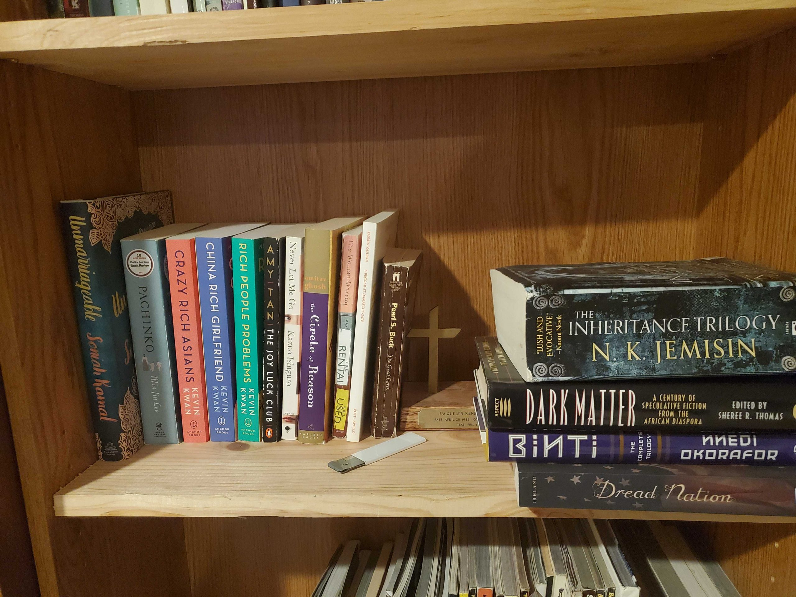 Bookshelf with Crazy Rich Asian series and others