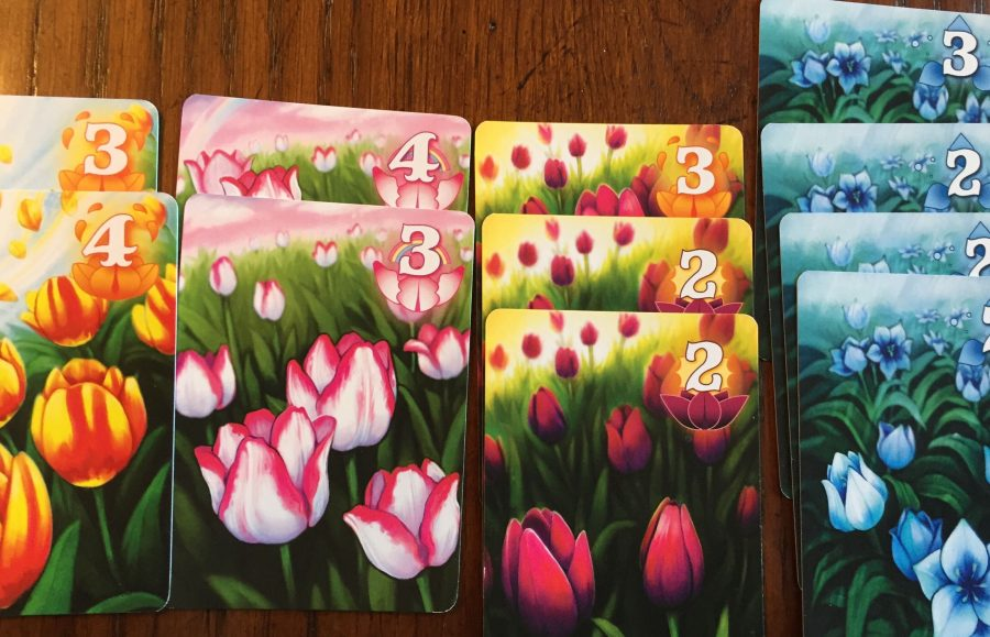 Four columns of Tulip cards, from Left to right: Orange (3, 4), Pink and White (4, 3), Purple (3, 2, 2), and Blue (3, 2, 2, 2).