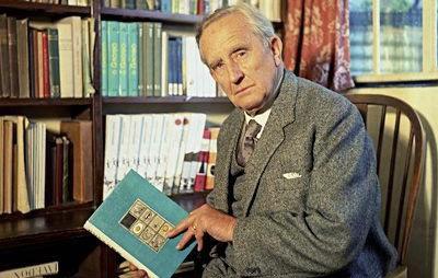 Older Tolkien holding a book
