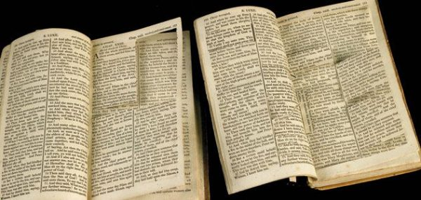 Two bibles with their pages carved out