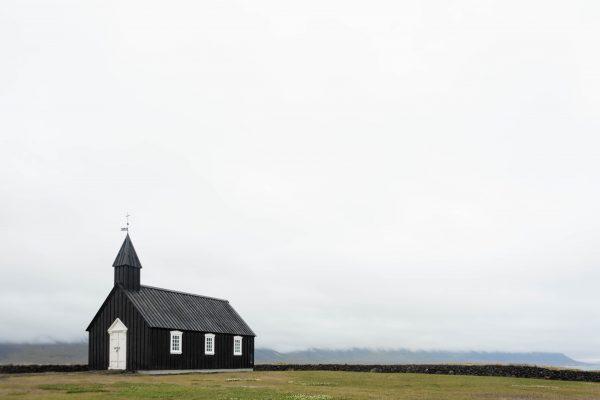 Lone church in a field of grass